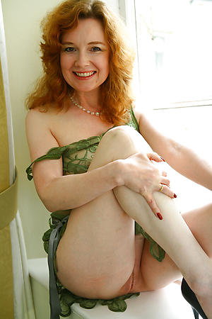 redhead hair granny with big tits posing nude