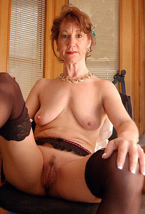 beautiful redhead granny stripping