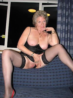 women regarding stockings posing nude