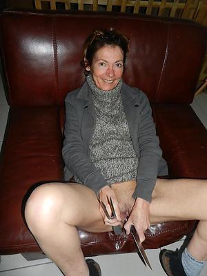 naked senior woman masturbates