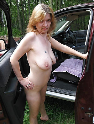 mature outdoors posing nude