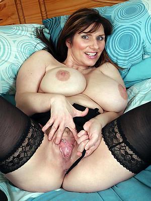 hot elegant granny stripping