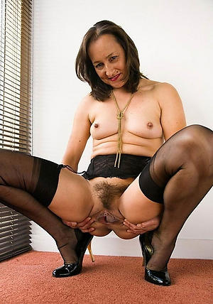 X-rated beauty granny in stockings