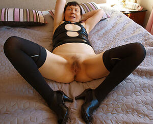 hot granny anent on one's high horse heels stripping