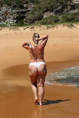 granny at beach posing nude