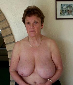 sizzling busty granny posing unadorned