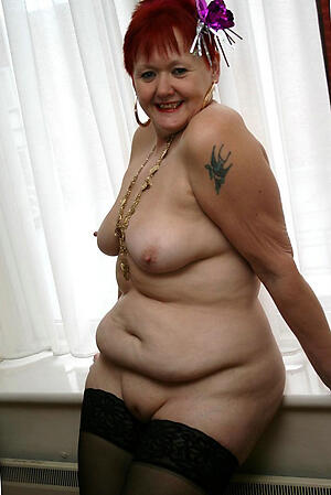 free pics of exposed busty redhead granny