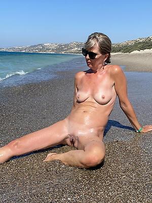 old women on beach adulate posing nude