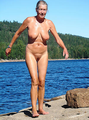 superannuated column on beach posing nude