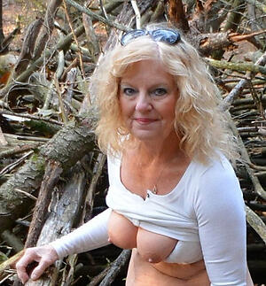 hot sexy blonde granny stripping